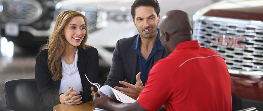 New car buying asking their dealer questions